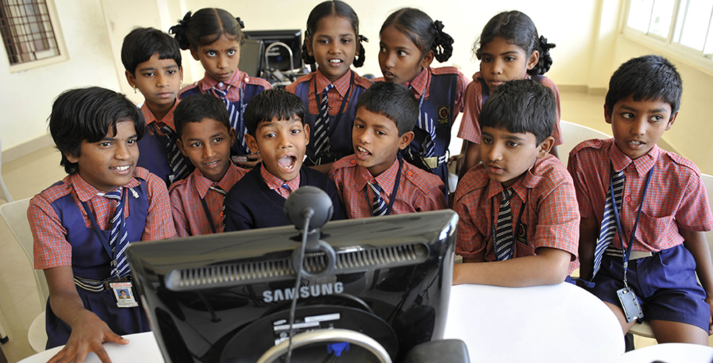 Schoolchildren in India interact via Skype; India is home to most of the world's Hindus and is a country with low overall education levels. (Niklas Halle'n/Barcroft India/Getty Images)