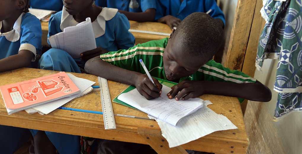 Nigerian refugee children attend classes in a UN Refugee Agency camp in Cameroon, one of several sub-Saharan Africa countries that have large attainment gaps between Muslims and Christians. (Reinnier Kaze/AFP/Getty Images)